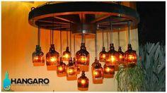 Diseño de lámpara con base de rueda de carreta y 19 botellas de whisky.  www.hangaro.gt #Hangaro #Guatemala #Vidrio #Botellas #CreacionChapina  Código: CH2101TR