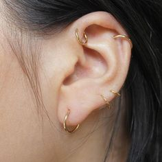 The Un Gold Hoop Earrings - worn in the first hole and cartilage