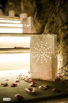 Paper lanterns and rose petals, for a romantic entrance.