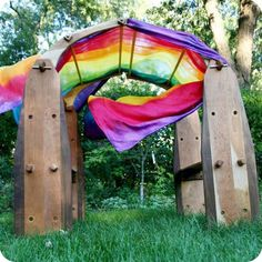 The Playstand Playroom has two sides joined together with wooden canopy arches. Includes two 12