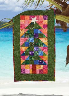 """""""Tropical Tree Banner"""" by Maria Umhey (from The Quilter Quilting for Christmas Holiday 2012 issue)"""