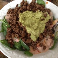 My friend, Taysha made this. Spinach, with 5% fat ground beef, salsa mixed with Greek yogurt for dressing, and Guacamole on top! Can't wait to make it!