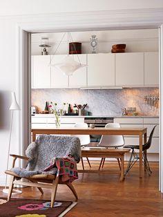 urbnite: AJ Floor Lamp by Arne Jacobsen Easy Chair by Hans Wegner Eames Molded Side Chair (Eiffel Base)