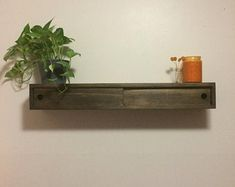 Rustic wood floating shelf with hidden compartment & magnetic Floating Media Console, Rustic Wood Floating Shelves, Wood Shelves, Display Shelves, Hidden Shelf, Hidden Compartments, Secret Compartment, Wall Decor Design, Hardware