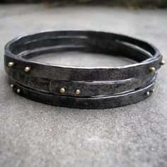 Gold and Steel Bracelets.  Riveted Stacking Bangles of Forged Steel and 18 KT Gold