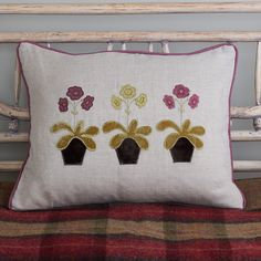 Each petal, leaf and flower pot on this beautiful Charcoal Auricula cushion is cut out by hand before being appliqued and delicately freehand embroidered onto our natural coloured linen. Finished with a silk edge and includes feather-filled cushion pad. Cushion Pads, Cushion Covers, Country Lounge, Susie Watson, Applique Cushions, Image Shows, Flower Pots, Charcoal, Feather
