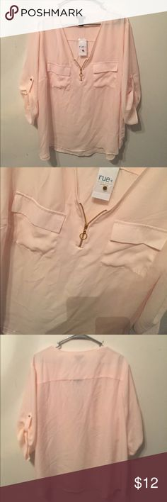 PLUS SIZE BLUSH TOP Plus size top with gold zipper detail, front pockets, and 3/4 sleeves. Rue21 Tops Blouses