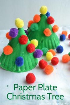 Christmas trees are everywhere this time of year. Bring them inside and to the craft table with these 12 Christmas tree crafts for kiddos!: Paper Plate Pom Pom Christmas Tree