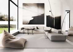 Masculine living space with a low sectional, large black and white photography, and a gray bean bag