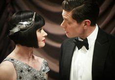 Photo of Jack & Phryne for fans of Miss Fisher's Murder Mysteries. Essie Davis as Phryne Fisher and Nathan Page as Detective Inspector John 'Jack' Robinson in 'Miss Fisher's Murder Mysteries'