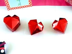 Origami Heart Box Tutorial (Make a paper heart shaped box) - Published on Jan 31, 2016 This heart shaped box is pretty easy to fold. You'll need two papers for one completed box, the paper for the lid is just a little larger then the paper for the box. I folded wrapping papers around standard papers to get real shiny heart boxes. More paper, craft and Origami fun at: