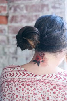 Nothing like gorgeous floral to add a touch of femininity to a neck tattoo.
