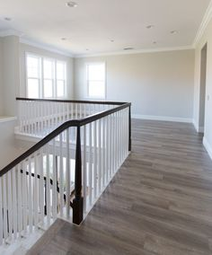 Our New Home | Upstairs Reveal - A Thoughtful Place. Walls: Pale Oak and trim:  White Shadow. Benjamin Moore.  New laminate flooring: USA Top Flooring and is called Caramel Swirl