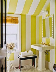 Happy yellow and white striped bathroom!