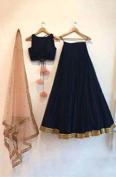 Navy blue silk lehenga choli set with a contrast embroidered peach dupatta. The lehenga choli is a c Indian Gowns Dresses, Indian Fashion Dresses, Dress Indian Style, Indian Designer Outfits, Indian Bridesmaid Dresses, Bridesmaid Outfit, Red Fashion, Maxi Dresses, Lehenga Choli