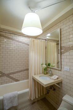 small bathroom gets updated with classic materials and modern light fixtures | www.j-jorgensen.com |