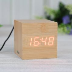 EiioX Mini Cube Holz Wecker Uhr Wood Mini Cube Würfel Rot LED Anzeige UBS Kable(eingeschlossen) EiioX http://www.amazon.de/dp/B00F2CC0OA/ref=cm_sw_r_pi_dp_SIHEub17ENJ4F