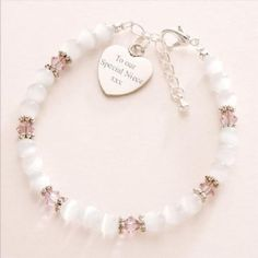 BIRTHSTONE AND CATS EYE BRACELET WITH ENGRAVED HEART http://www.jewels4girls.net/birthstone-and-cats-eye-bracelet-with-engraved-heart-140-p.asp