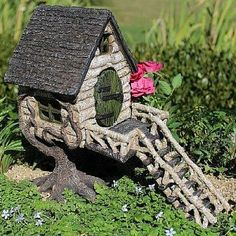 River Birch Tree House. www.teeliesfairygarden.com . . .The River Birch Tree House is made to attract all wandering fairies and birds. It features a wonderful staircase and swinging door. #fairyhouse