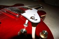 Epiphone Casino Cherry Red Taken with Nikon D3100 (sorry for the dust)