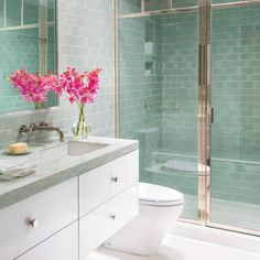 Seafoam Green Bathroom - Colorful Beach Condo Makeover - Coastal Living