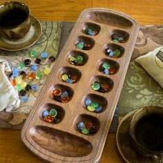 Our beautiful handcrafted mancala boards are made using solid cherry or walnut and a traditional hand-rubbed finish. Each handmade wooden mancala game board comes with a set of glass playing pieces in a cotton bag. Custom engraving is available. Handmade Wooden Toys, Wooden Diy, Cherry Games, Cherry Products, Coffee Table Games, Mancala Game, Cribbage Board, Wood Games, Easy Wood Projects