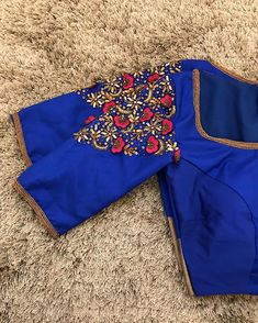 Pleated puff sleeves are classics and could always be chosen when in doubt. This royal blue pleated puff sleeve blouse comes with… Wedding Saree Blouse Designs, Pattu Saree Blouse Designs, Blouse Designs Silk, Blouse Patterns, Simple Blouse Designs, Stylish Blouse Design, Camilla, Blouse Designs Catalogue, Hand Embroidery