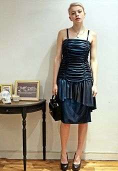 £12.00...Vintage 60's Metallic Blue Ruffle Dress// This is a handpicked vintage item by Pretty Disturbia, perfect for the party season.   FABRIC: Polyester, has a little stretch.  DETAIL: Zip fastening.  STYLING- Our PD stylists would wear this dress under our net dress with heels and a handbag, perfect for your Christmas Party.  SIZE-14   WASHING INSTRUCTIONS- Dry Clean Only.   MODEL - Note that the model is a size 10.   Please note, we also do hassle free returns and are here if you have…