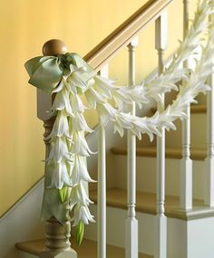 Wedding Decorations Lily Garland for a Wedding Perfume your ceremony or reception site with a garland of sweetly scented lilies, most abundant in spring. Garland How-To Next: Wedding Rosette Chandeliers White Wedding Decorations, Garland Wedding, Aisle Decorations, Decor Wedding, Plan Your Wedding, Dream Wedding, Wedding Day, Wedding Church, Lily Wedding