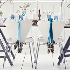 Adding wintery pinecones to the back of your dining room chairs is a cheap and beautiful decoration: http://www.bhg.com/christmas/crafts/low-cost-christmas-projects/?socsrc=bhgpin121713pineconechairdecorations&page=11