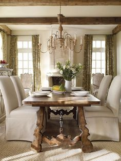 slipcovered chairs & trestle dining table