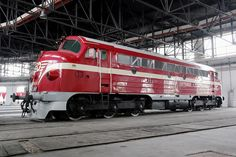 """Hungarian State Railways MAV preserved NoHAB diesel engine M61.001 inside the roundhouse of Budapest Railway Museum """"Füsti"""", representing the original livery of this class."""