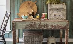 Witty cutting boards and creative storage containers add even more character to a salvaged worktable. (That vintage breadbox houses silverware!) Click to see the full rustic kitchen tour from Country Living!