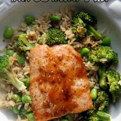Soy Sauce and brown sugar glaze on top of broiled salmon, served on a bed of brown rice with broccoli florets and edamame beans.