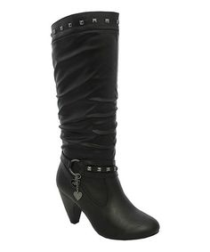 Nothing says attitude like a high-heel boot, and this faux leather beauty is no exception. Trimmed with studs and boasting a dangling charm, it makes for sweet-n-sassy steps. 3'' heel14'' shaft18'' circumference Zipper closureMan-madeImported