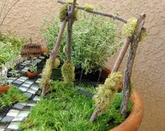 """Fairy Garden Swing tutorial - love the poles and moss. I think I might use jute instead of chains (just cuz it """"feels"""" more right in a mini garden) but this is super-cute as is. Twining flowers would be nice too.   ********************************************   ShabbyBeachNest - #fairy #garden #gardens #miniature #miniatures #crafts #DIY #whimsy #whimsical #swing - tå√"""
