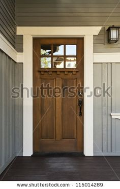 stock photo : Dark wood front door of a home. View of a rustic front door on a light gray home during the day. Craftsman door with gray paneled house House, Home, House Exterior, New Homes, Exterior Doors, Rustic Doors, Rustic Front Door, Doors, House Colors