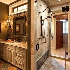 Love the two-headed shower, but I really like the tile above the sink. Would love to do this in our bathroom
