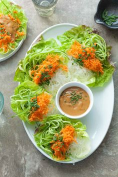 Cucumber and Kelp Noodle Lettuce Wraps with Sesame Sunflower Sauce (Raw, Paleo, Vegan) - carrots, cucumber, kelp noodles and a creamy sesame sunflower sauce fill these summer roll inspired lettuce wraps.