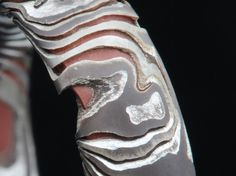 Why you don't want a copper and silver mokume gane ring. so here the copper has eroded back and left the shapes and details in silver, that why most people incase the mokume gane in a band of silver or gold