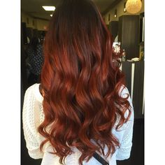 This hairstyle features a beautiful balayage technique to bring out shades of fiery red color. Get this hairspiration for your own gorgeously red tresses.
