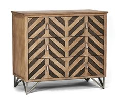 Modular-style oak chevron chest, with a herringbone patter finished in Honey Oak and Havana Oak with antique nickel accents. Abode, 2144 Veterans Memorial Blvd., 266-2135, sopatabode.com