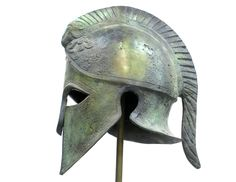 Armour & Weapons :: Full Size Helmets :: Ancient Greek life size helmet with ram crest from Arcadia on the Peloponnese. This Corinthian style helmet bears a ram crest, probably belonging to a high ranking officer of the Arcadian hoplite army. Dated to 400 B.C. Handmade in Greece of solid bronze, an exact museum reproduction.