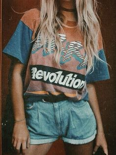 90's vibe. Revolution. High waisted jean shorts and a retro shirt and choker.