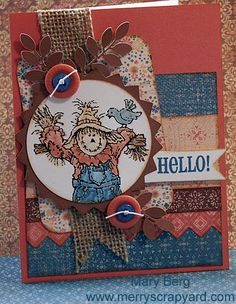 This is different from all the other scarecrow cards I've done, because they stamped it in a cropped circle.  I like that, and I like it with the Clementine paper.