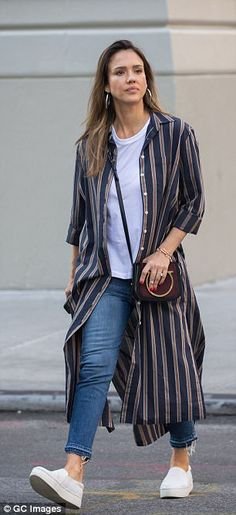 Chic: Adding a touch of panache to her outfit, Jessica added striped longline shirt with the sleeves rolled up and a vintage inspired handbag worn across her body