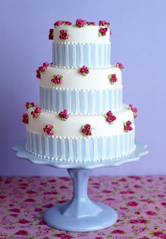 Blue and white stripe vintage wedding cake with pink roses