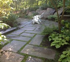 granite patio hideaway with Muskoka chairs