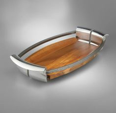 by Nambe In Nambé's aerodynamic Anvil Tray, a juxtaposition of earthy wood and industrial-chic metal is the epitome of sleek, modern design. But naturally, it's not all about looks: Our sturdy tray is a functional accessory for breakfast in bed, or simply for indulging in some treats while reclining in the family room. A lovely gift for anyone who enjoys a bit of indulgence...every day!