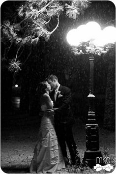 Kissing in the snow under an old fashioned street lamp by MKD Photography, via Flickr